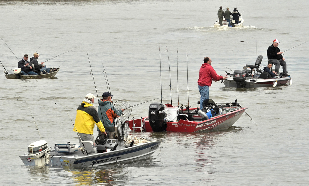 Description of . Boats on the Hudson near the Postenkill outlet. The Troy 9th annual Ale House Striped Bass tournament, Saturday May 3, 2014 (Mike McMahon - The Record)
