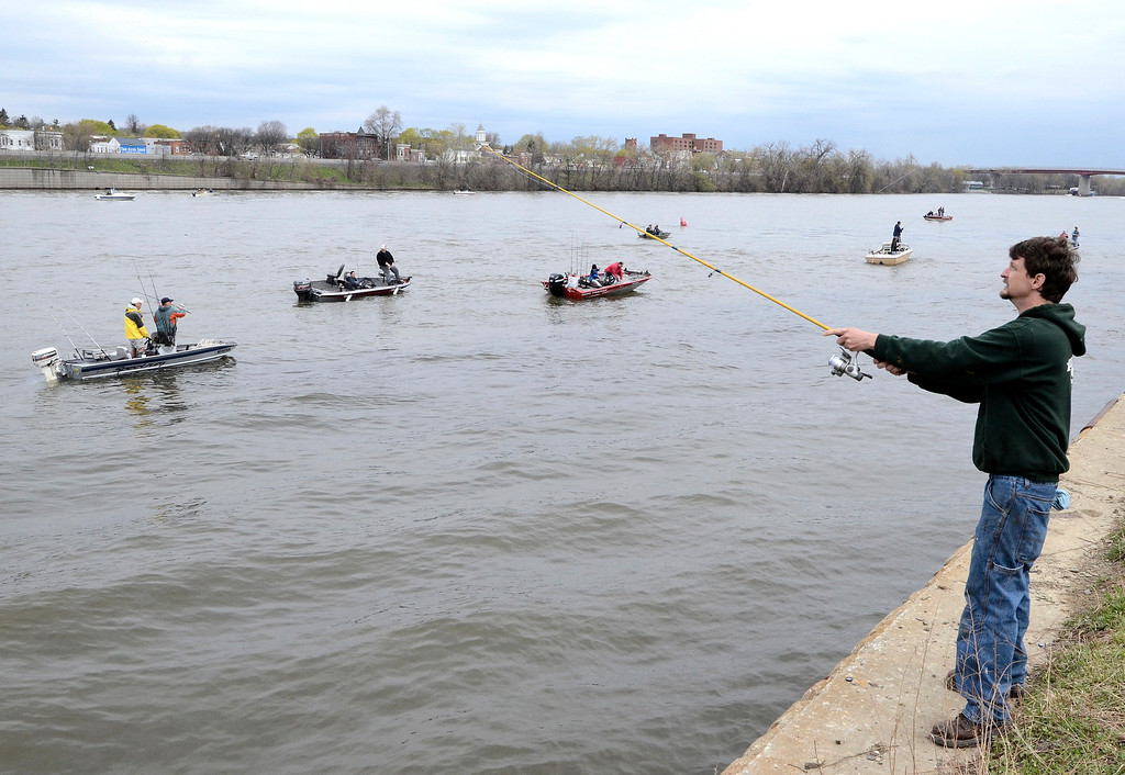 Description of . Dave Morelli of Snyders Lake fishes off Madison Street. The Troy 9th annual Ale House Striped Bass Tournament, Saturday May 3, 2014 (Mike McMahon - The Record)