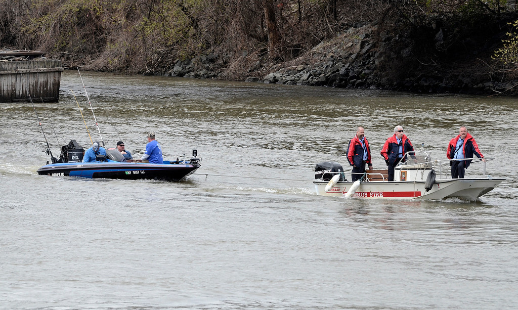 Description of . This boat get towed back to boat ramp by Troy Fire Department after engine proplems on the hudsonThe Troy 9th annual Ale House Striped Bass tournament, Saturday May 3, 2014 (Mike McMahon - The Record)