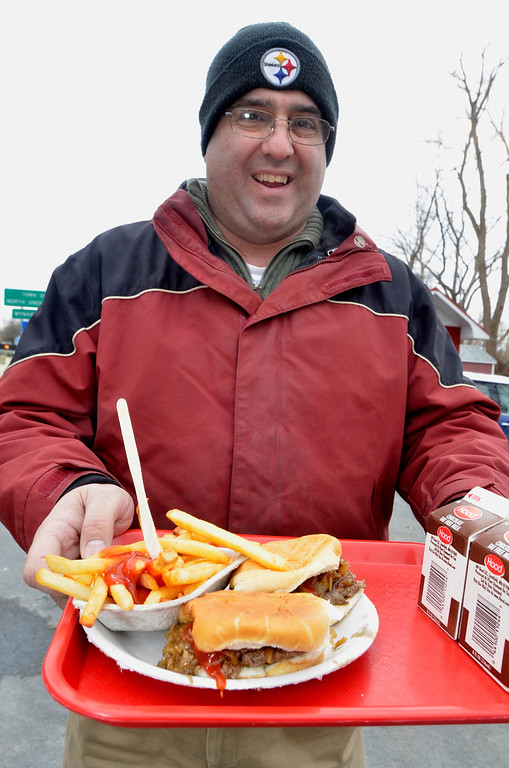 Description of . Mike McMahon - The Record, Dave Alber with two Sliders and fries at Jack's Drive-In opening for it's 76th season in Wynantskill, Wednesday March 13, 2014.