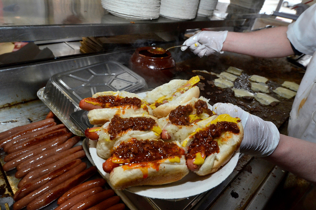 Description of . Mike McMahon - The Record, New this year mini dogs with onions and Greek meat sauce. Jack's Drive-In opens for it's 76th season in Wynantskill, Wednesday March 13, 2014.