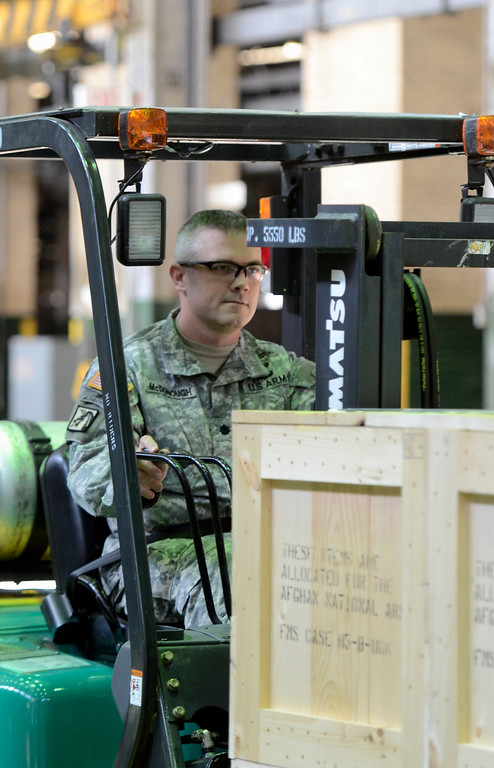 Description of . Lt. Col. William McDonough operates a fork lift to load the  last 60mm mortar order to the Afghanistan National Army to close a nearly $6 million contract to manufacture 900 mortar systems.  The order is a significant step needed to bring our troops home. September 16. 2013.  (Mike McMahon/The Record)
