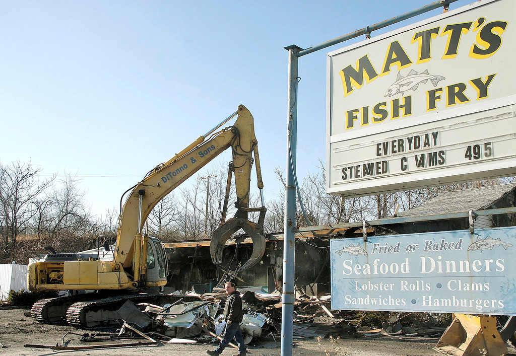 Description of . Mike McMahon - The Record, Matt's Fish Fry was demolished after a early morning fire Wednesday morning, Tuesday March 30, 2014