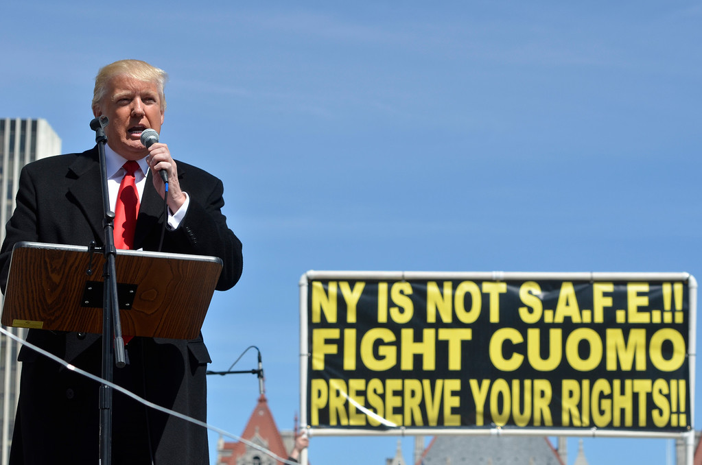 Description of . J.S.CARRAS/THE RECORD Donald Trump, left, and Carl Paladino, who ran for governor of New York as a Republican in 2010, speak during a gun rights rally at the Empire State Plaza. Activists are seeking a repeal of a 2013 state law that outlawed the sales of some popular guns like the AR-15. The law championed by Gov. Andrew Cuomo has been criticized as unconstitutional by some gun rights activists Tuesday, April 1, 2014 in Albany, N.Y..