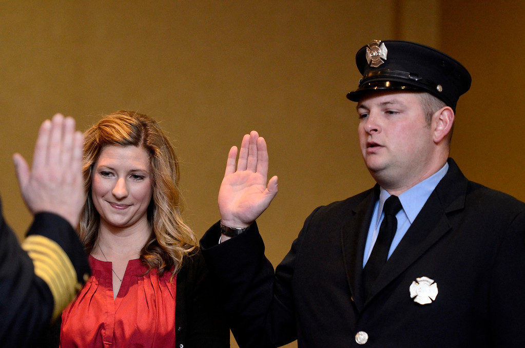 Description of . Mike McMahon - The Record,  Troy Fire Department promoted David Wheeler from firefighter to Lieutenant at the Hilton Garden Inn in Troy, Tuesday, November 19, 2013