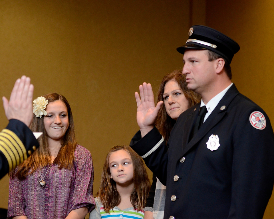 Description of . Mike McMahon - The Record,  Troy Fire Department promoted Michael Bayly from Lieutenant to Captain at the Hilton Garden Inn in Troy, Tuesday, November 19, 2013