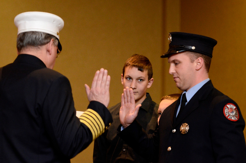 Description of . Mike McMahon - The Record,  Troy Fire Department promoted Corey Christensen from firefighter to Lieutenant at the Hilton Garden Inn in Troy, Tuesday, November 19, 2013