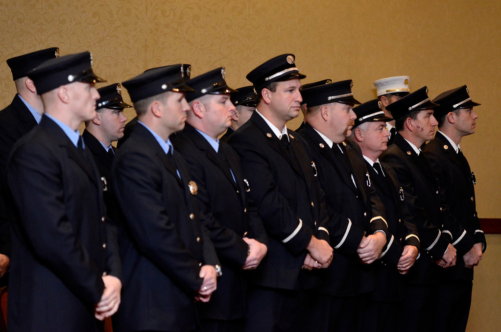 Description of . Mike McMahon - The Record,  Troy Fire Department promoted 5 men from Lieutenant to Captain and 8 men from firefighter to Lieutenant at the Hilton Garden Inn in Troy, Tuesday, November 19, 2013