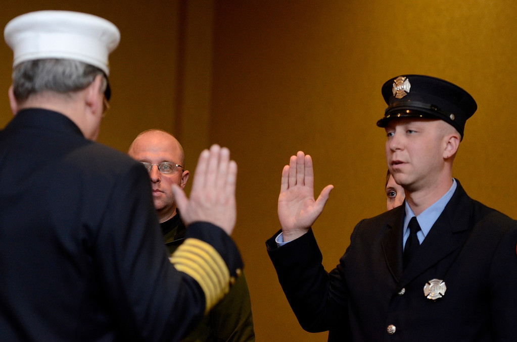 Description of . Mike McMahon - The Record,  Troy Fire Department promoted Matthew Matthew Dwon from firefighter to Lieutenant at the Hilton Garden Inn in Troy, Tuesday, November 19, 2013