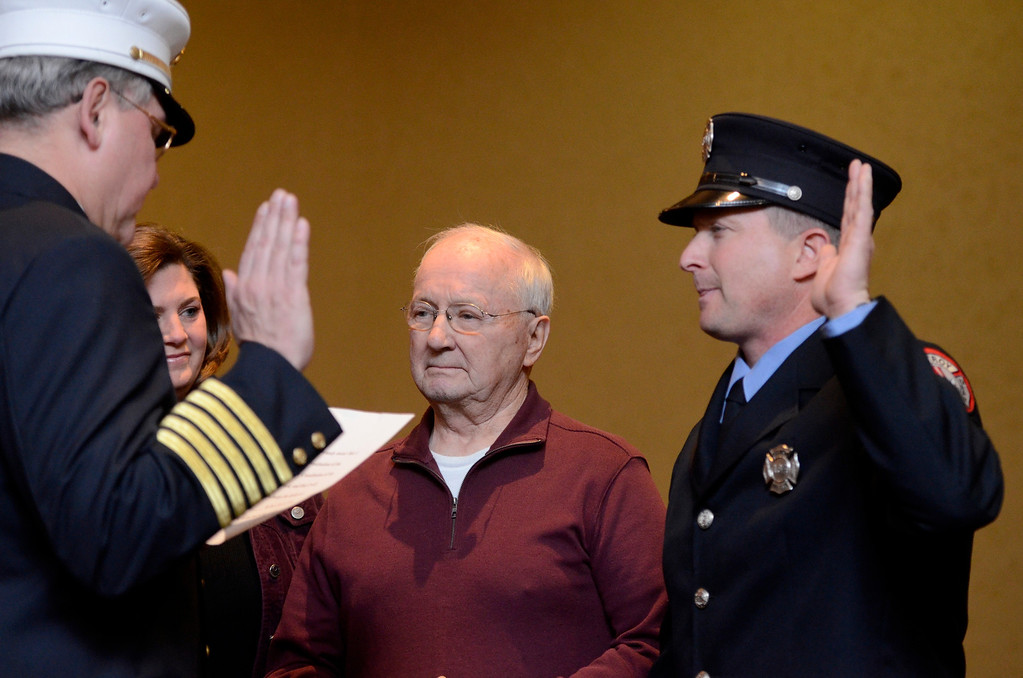 Description of . Mike McMahon - The Record,  Troy Fire Department promoted Scott McNeff from firefighter to Lieutenant at the Hilton Garden Inn in Troy, Tuesday, November 19, 2013
