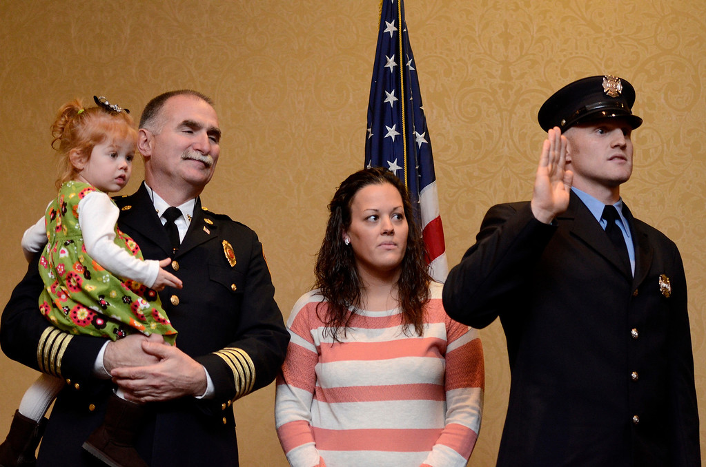 Description of . Mike McMahon - The Record,  Troy Fire Department promoted Patrick Shaw  from firefighter to Lieutenant at the Hilton Garden Inn in Troy, here with his daughter Molly, father Peter Shaw Saratoga Springs Assistant Fire Chief and wife Ashley Shaw, Tuesday, November 19, 2013