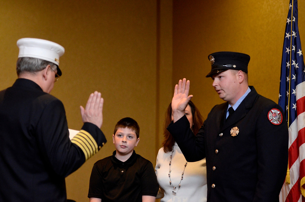 Description of . Mike McMahon - The Record,  Troy Fire Department promoted Jeffrey Ward from firefighter to Lieutenant at the Hilton Garden Inn in Troy, Tuesday, November 19, 2013