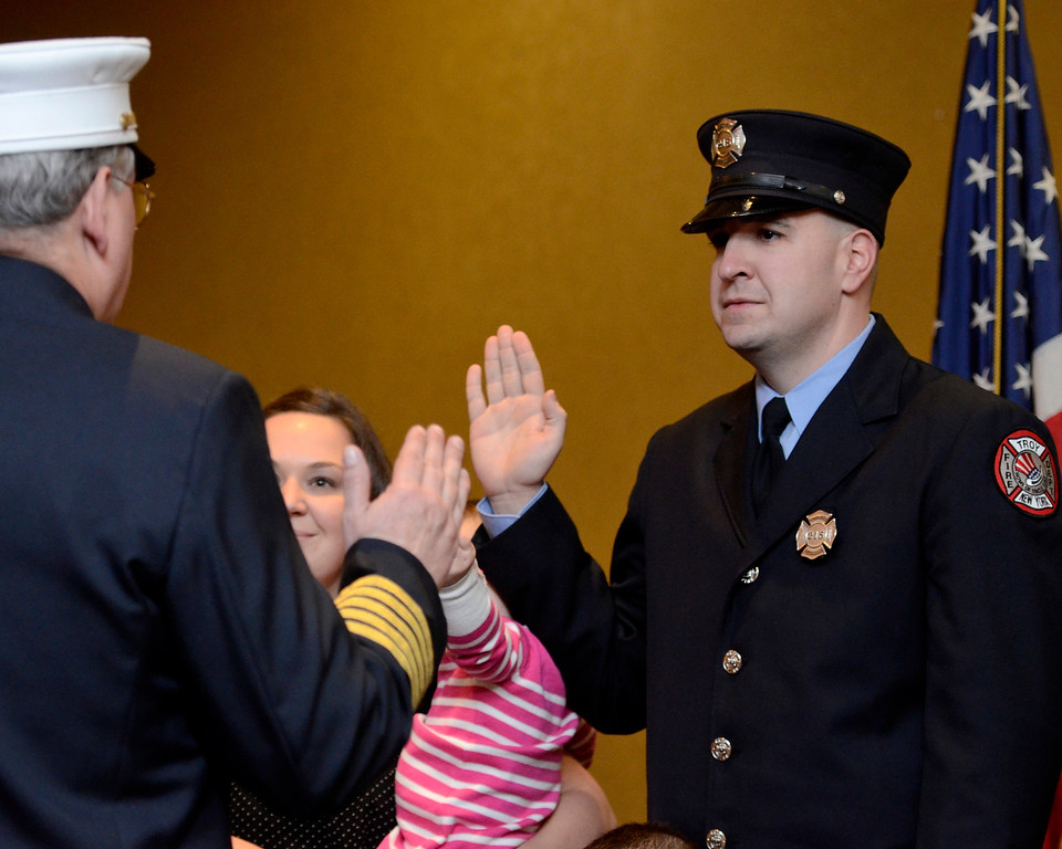 Description of . Mike McMahon - The Record,  Troy Fire Department promoted Ryan Handerhan from firefighter to Lieutenant at the Hilton Garden Inn in Troy, Tuesday, November 19, 2013