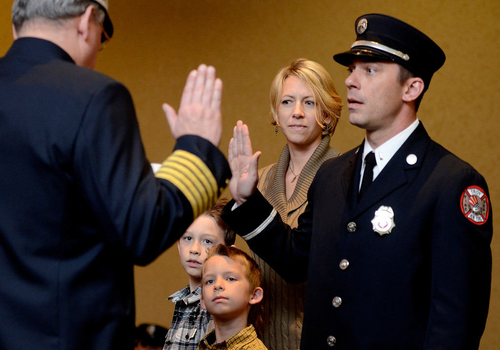 Description of . Mike McMahon - The Record,  Troy Fire Department promoted Matthew Dudek from Lieutenant to Captain at the Hilton Garden Inn in Troy, Tuesday, November 19, 2013