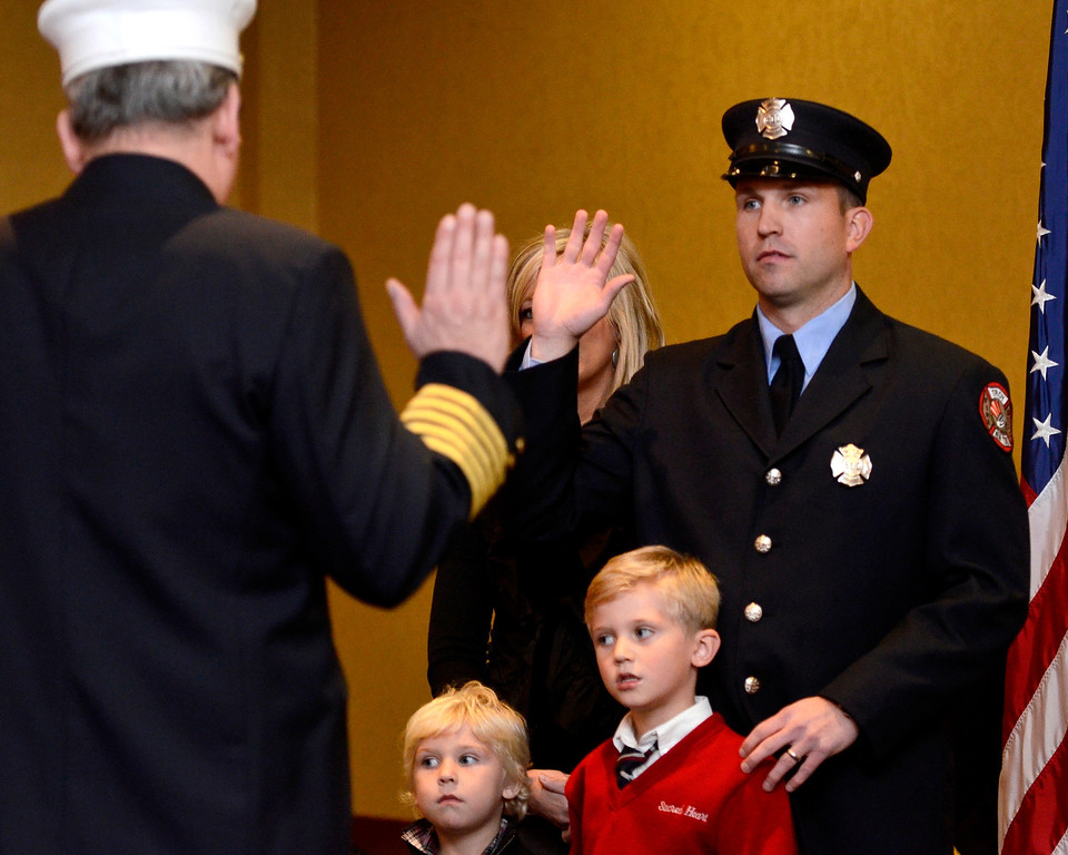 Description of . Mike McMahon - The Record,  Troy Fire Department promoted Kevin Kilgallon from firefighter to Lieutenant at the Hilton Garden Inn in Troy, Tuesday, November 19, 2013