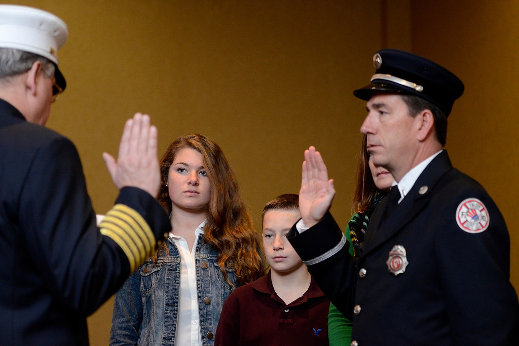 Description of . Mike McMahon - The Record,  Troy Fire Department promoted Frank Shoemaker from Lieutenant to Captain at the Hilton Garden Inn in Troy, Tuesday, November 19, 2013