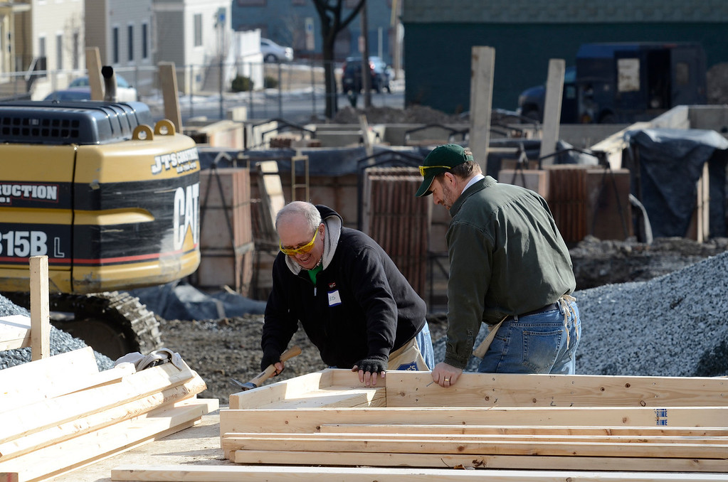 Description of . J.S.CARRAS/THE RECORD Volunteers from CDPHP work to build house for Habitat for Humanity Capital District and Capital Region Sponsor-A-Scholar Saturday, December 28, 2013 at 204 Sheridan Avenue in Albany, N.Y..