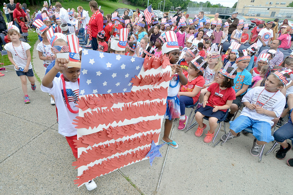 Description of . Mike McMahon - The Record ,  Kindergarden student carry a flag constructed of hands at Troy's School 14 celebrate
