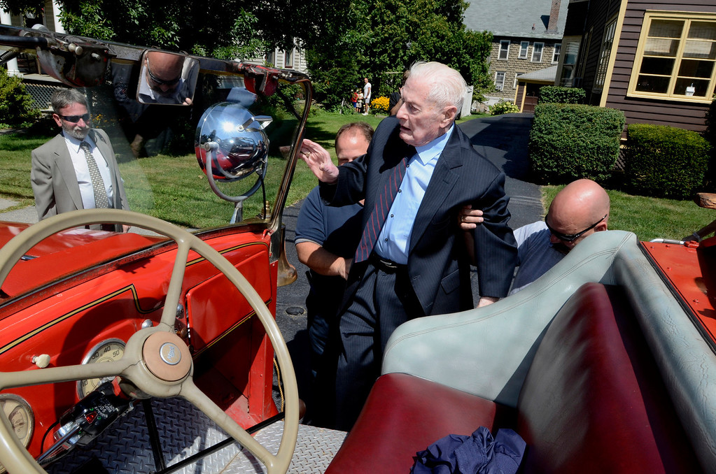 Description of . Frank J. Kennedy, the oldest living Troy firefighter, celebrated his 100th birthday (August 22) with a ride on an antique 1947 Mack fire truck to his last fire station on Canal Ave in Troy, N.Y., Sunday, August 25, 2013.. (Mike McMahon/The Record)