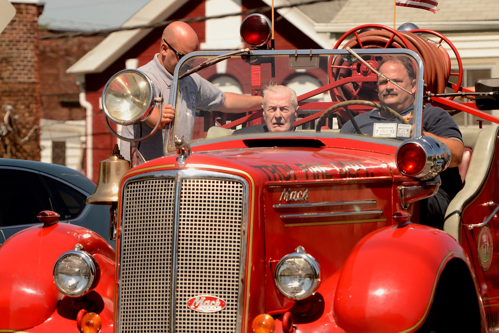 Description of . Troy firefighter Mike DeForge, Frank J. Kennedy and  Troy Firefighter Eric Wisher, ride a 1947 Mack Fire Pumper. Frank J. Kennedy, the oldest living Troy firefighter, celebrated his 100th birthday (August 22) with a ride on an antique 1947 Mack fire truck to his last fire station on Canal Ave in Troy, N.Y., Sunday, August 25, 2013.. (Mike McMahon/The Record)