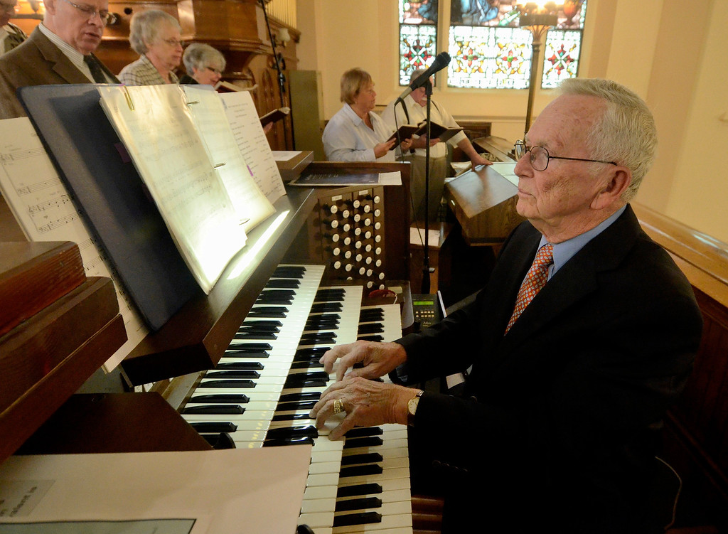 Description of . Mike McMahon - The Record, Choir director Stanley Muraski plays the organ. St. Mary of the Assumption Parish celebrated 100 years with a mass at the Waterford Church, Sunday 10/06/2013.