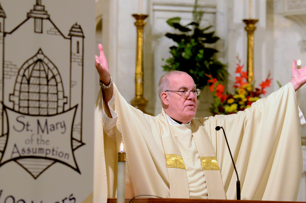 Description of . Mike McMahon - The Record, Rev. Anthony Genovese, O.S.A., gives the Homily. St. Mary of the Assumption Parish celebrated 100 years with a mass at the Waterford Church, Sunday 10/06/2013.