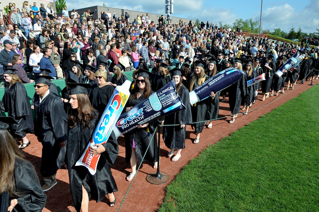 Description of . Dental Hygiene graguates at Hudson Valley Community College commencement at the Joseph L. Bruno baseball field in Troy, Saturday  May 17,  2014 (Mike McMahon - The Record)