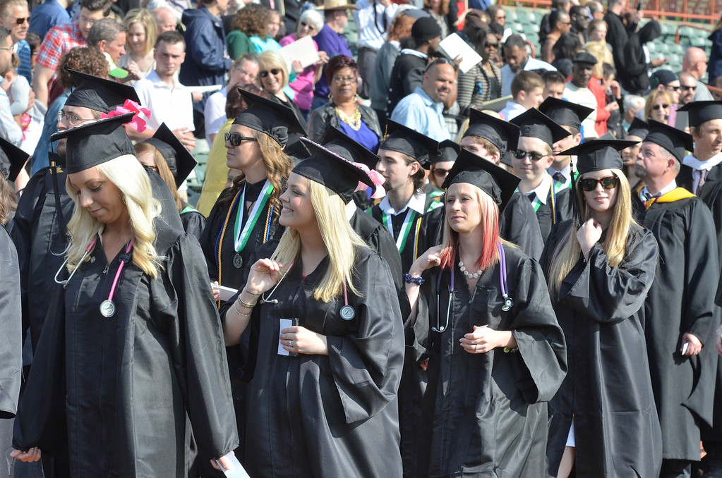 Description of . Hudson Valley Community College commencement at the Joseph L. Bruno baseball field in Troy, Saturday  May 17,  2014 (Mike McMahon - The Record)