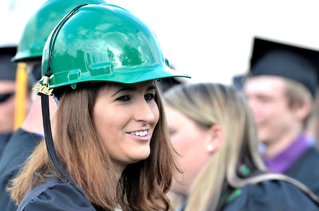 Description of . Construction Technologies graduate Kelly Doherty of East Greenbush wears a green construction helmet at Hudson Valley Community College commencement at the Joseph L. Bruno baseball field in Troy, Saturday  May 17,  2014 (Mike McMahon - The Record)