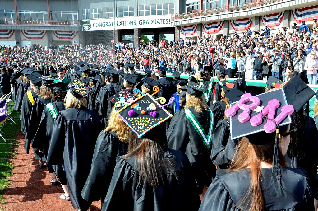 Description of . Nursing graduates with decorated mortars at Hudson Valley Community College commencement at the Joseph L. Bruno baseball field in Troy, Saturday  May 17,  2014 (Mike McMahon - The Record)
