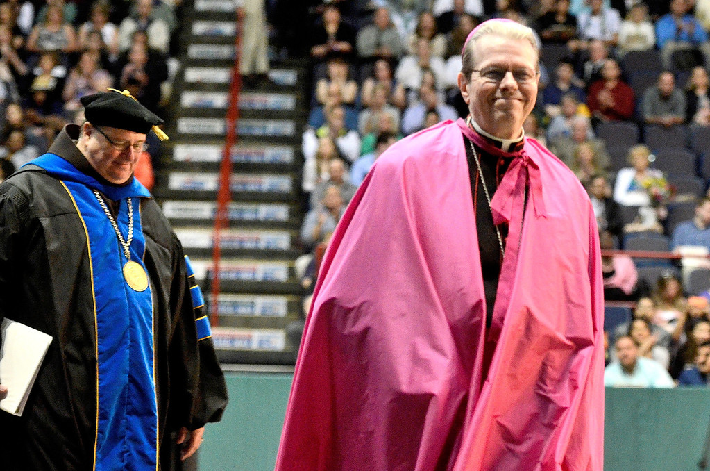 Description of . L-R Siena President Fr. Kevin Mullen andEdward B. Scha fenberger, D.D., Bishop of Albany at Siena College commencement at the Times Union Center in Albany, Sunday  May 18,  2014 (Mike McMahon - The Record)