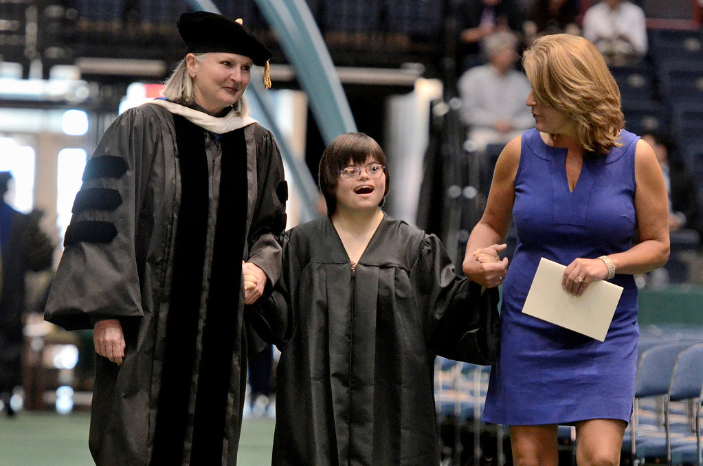 Description of . Dr. Meg Woolbrigh,t Emily Jahn who is graduation fron the Transition Program  and  Heather Hanrahan Special Education teacher at Shaker High School, Siena College commencement at the Times Union Center in Albany, Sunday  May 18,  2014 (Mike McMahon - The Record)