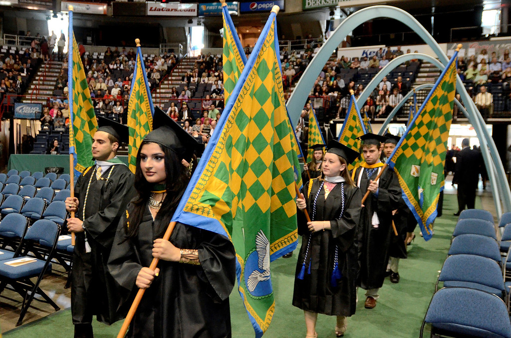Description of . Siena College students receiving awards for excellence in major fields carry flags in commencement procession at the Times Union Center in Albany, Sunday  May 18,  2014 (Mike McMahon - The Record)