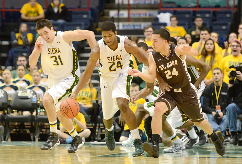 Description of . J.S.Carras/The Record  Siena's Brett Bisping (31) and Lavon Long (24) move ball up court against St. Bonaventure's Matthew Wright (24) during first half of men's college basketball action Tuesday, November 19, 2013 Times Union Center in Albany, N.Y..