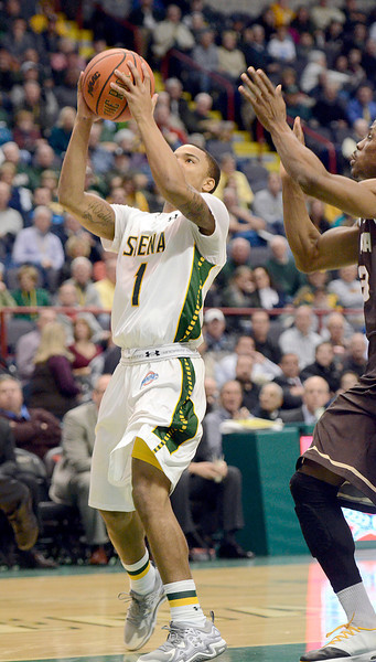 Description of . J.S.Carras/The Record  Siena's Marquis Wright drives to the basket against St. Bonaventure during first half of men's college basketball action Tuesday, November 19, 2013 Times Union Center in Albany, N.Y..