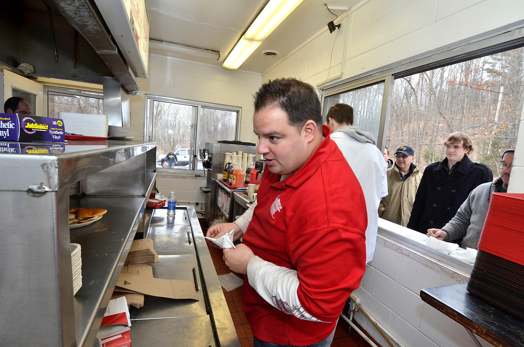 . Mike McMahon - The Record, Al Deeb manages the counter at Jack\'s Drive-In opening for it\'s 76th season in Wynantskill, Wednesday March 13, 2014.