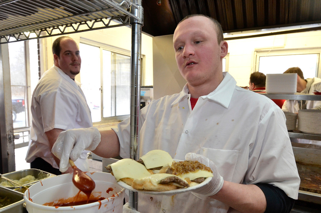 . Mike McMahon - The Record,  Nick Coli mans the fries and Dave Allens assembles the sliders at Jack\'s Drive-In opening for it\'s 76th season in Wynantskill, Wednesday March 13, 2014.