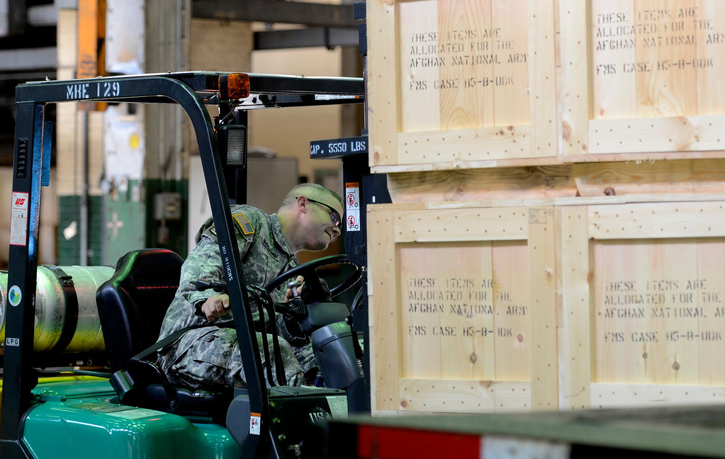 . Lt. Col. William McDonough operates a fork lift to load the  last 60mm mortar order to the Afghanistan National Army to close a nearly $6 million contract to manufacture 900 mortar systems.  The order is a significant step needed to bring our troops home. September 16. 2013.  (Mike McMahon/The Record)