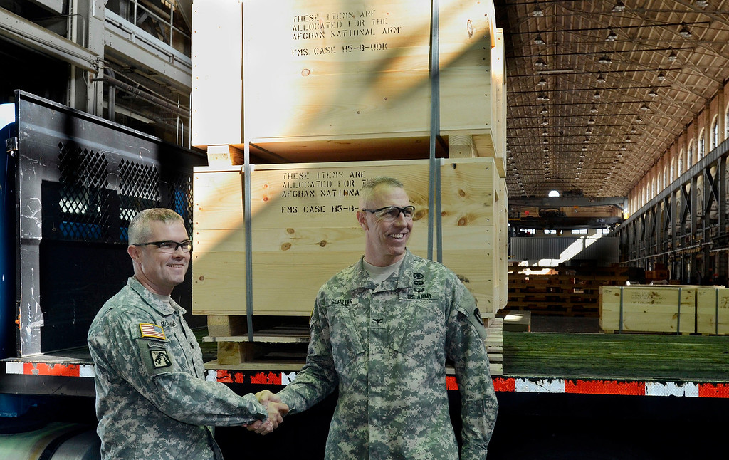 . Lt Col Willian McDonough and Col Lee Schiller with the Watervliet Arsenal shipment of the last 60mm mortar order to the Afghanistan National Army to close a nearly $6 million contract to manufacture 900 mortar systems.  The order is a significant step needed to bring our troops home. September 16. 2013.  (Mike McMahon/The Record)