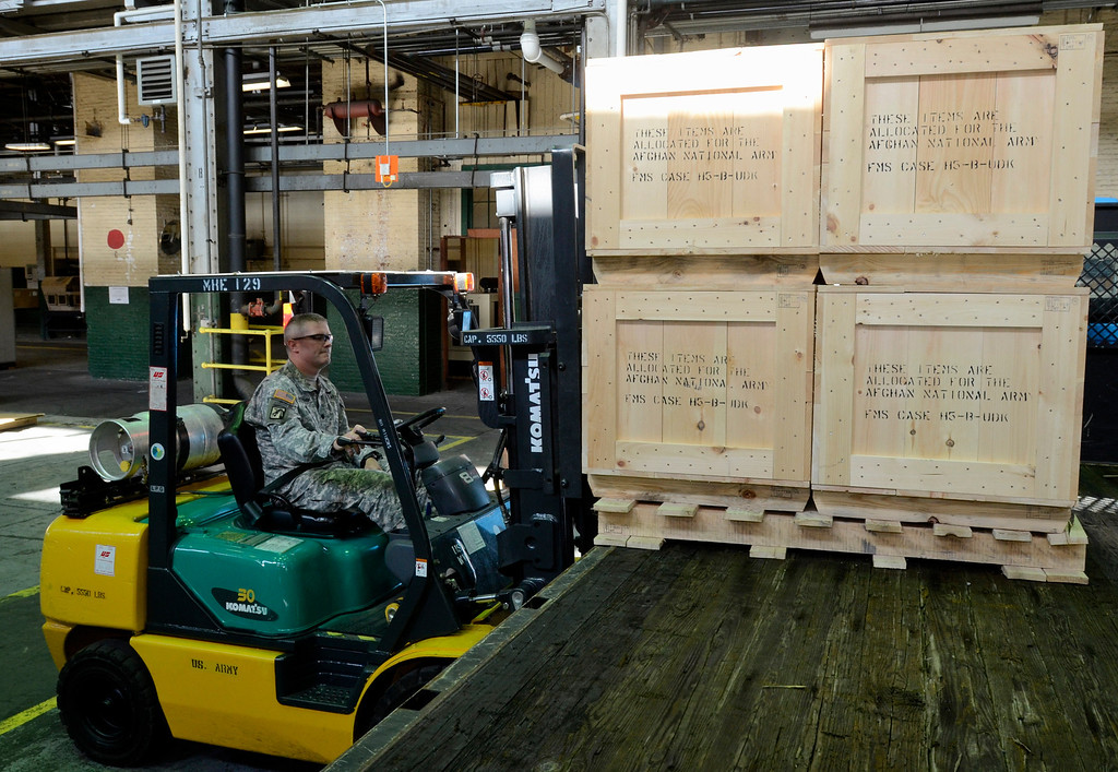 . Lt. Col. William McDonough loads a pallet of 60mm mortors on a truck. The Watervliet Arsenal shipped out the last 60mm mortar order to the Afghanistan National Army to close a nearly $6 million contract to manufacture 900 mortar systems.  The order is a significant step needed to bring our troops home. September 16. 2013.  (Mike McMahon/The Record)