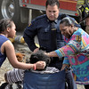 Mike McMahon - The Record, Family members console a woman rescued from a 2nd floor apartment at a fully involved 2-alarm fire at 554 4th Street in Troy, Wednesday April 16, 2014
