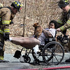 Mike McMahon - The Record, Woman and her dog rescued from 2nd floor apartment at a fully involved 2-alarm fire at 554 4th Street in Troy, Wednesday April 16, 2014