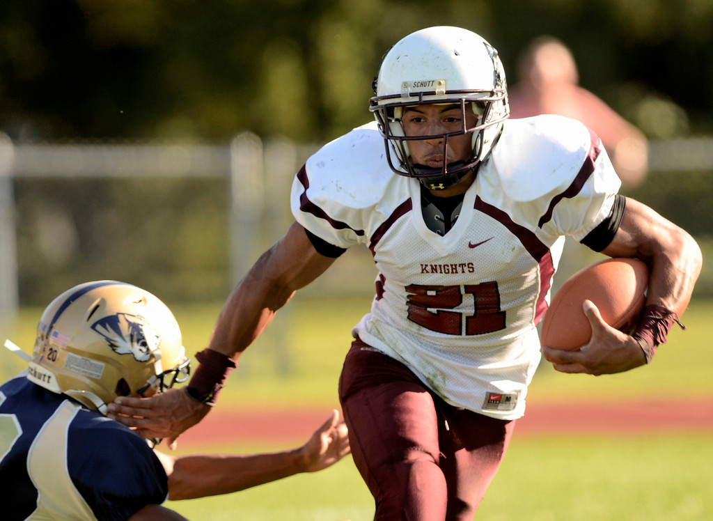 . Mike McMahon - The Record,  Lansingburgh Knights Anthony Walker escapes a  tackle for  a touchdown that was called back on a penalty in first quarter at Cohoes Tigers High School football Friday, September 20, 2013.
