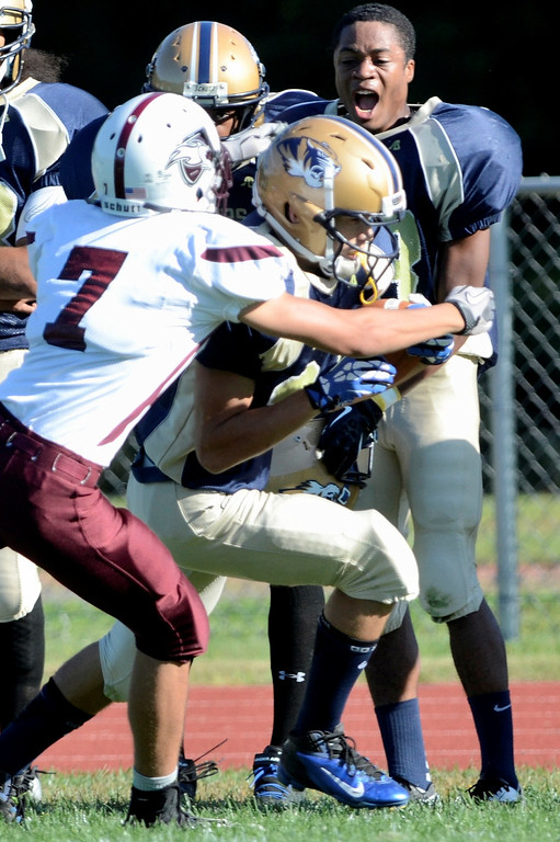 . Mike McMahon - The Record,  Lansingburgh Knights at Cohoes Tigers High School football Friday, September 20, 2013.