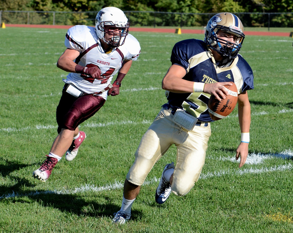. Mike McMahon - The Record, Cohoes QB Max Carey makes big yardage on a option in the first quarter chased by  Lansingburgh Knights Jordan Cloutier at Cohoes Tigers High School football Friday, September 20, 2013.
