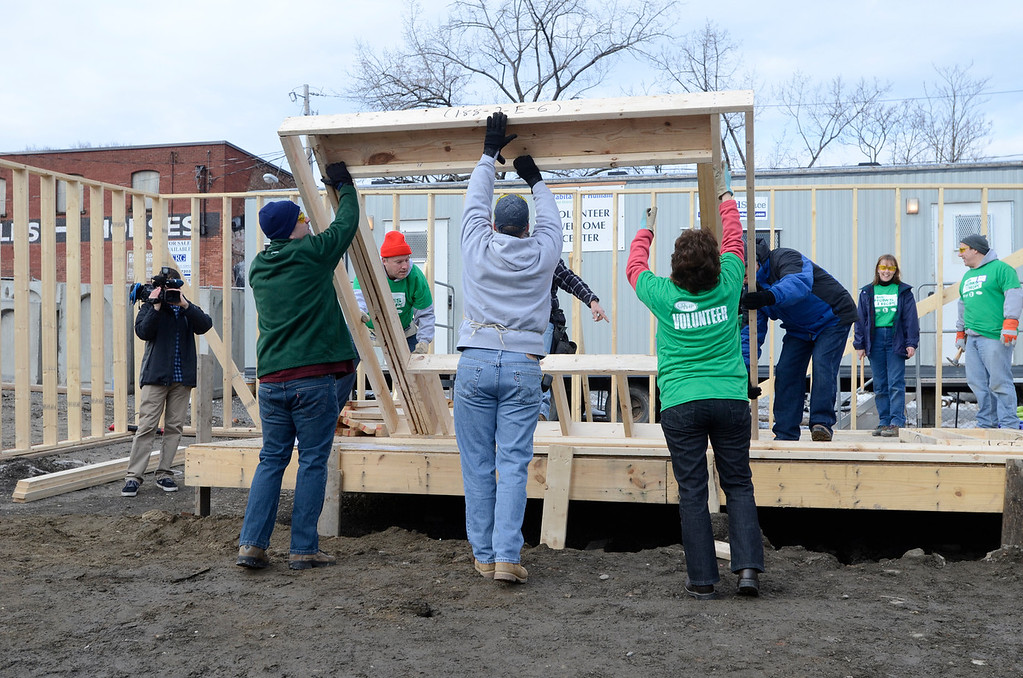 . J.S.CARRAS/THE RECORD Volunteers from CDPHP work to build house for Habitat for Humanity Capital District and Capital Region Sponsor-A-Scholar Saturday, December 28, 2013 at 204 Sheridan Avenue in Albany, N.Y..