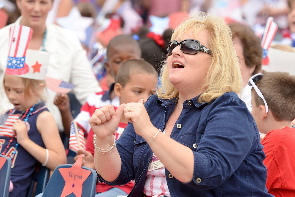 """. Mike McMahon - The Record ,  Teacher Patty Weaver-Lipscomb directs the singing of \""""I Love America\"""" Troy\'s School 14 celebrate \""""Red, White and Blue\"""" day to honor the flag and patriotism,  Friday June 6, 2014"""