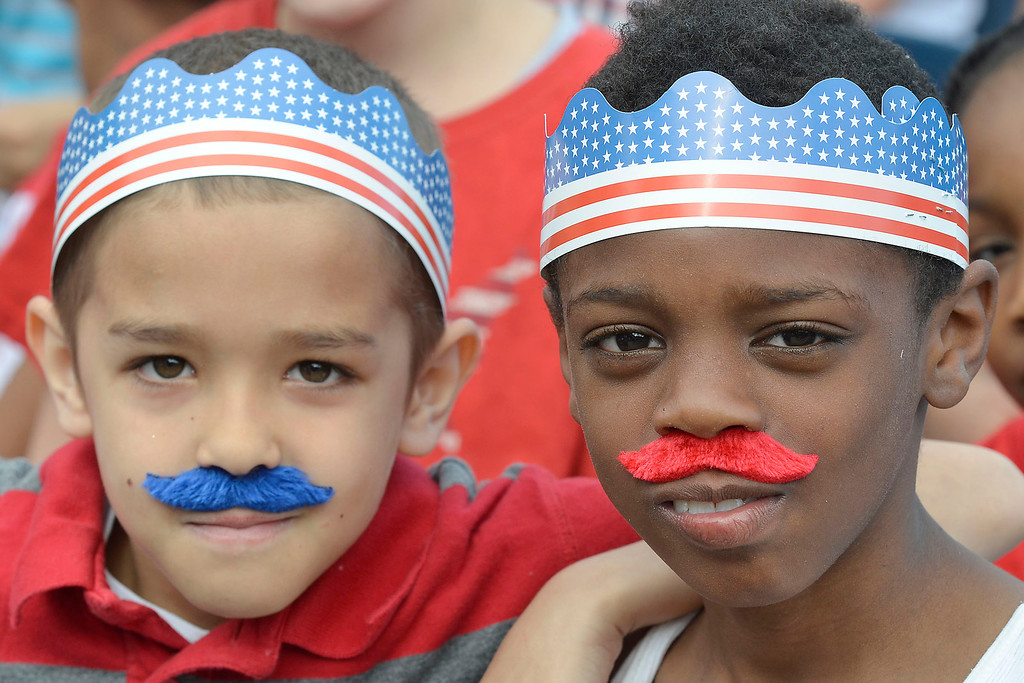 """. Mike McMahon - The Record ,  Frank Smith and Jeremiah Myers in ins grade at Troy\'s School 14 celebrate \""""Red, White and Blue\"""" day to honor the flag and patriotism,  Friday June 6, 2014"""