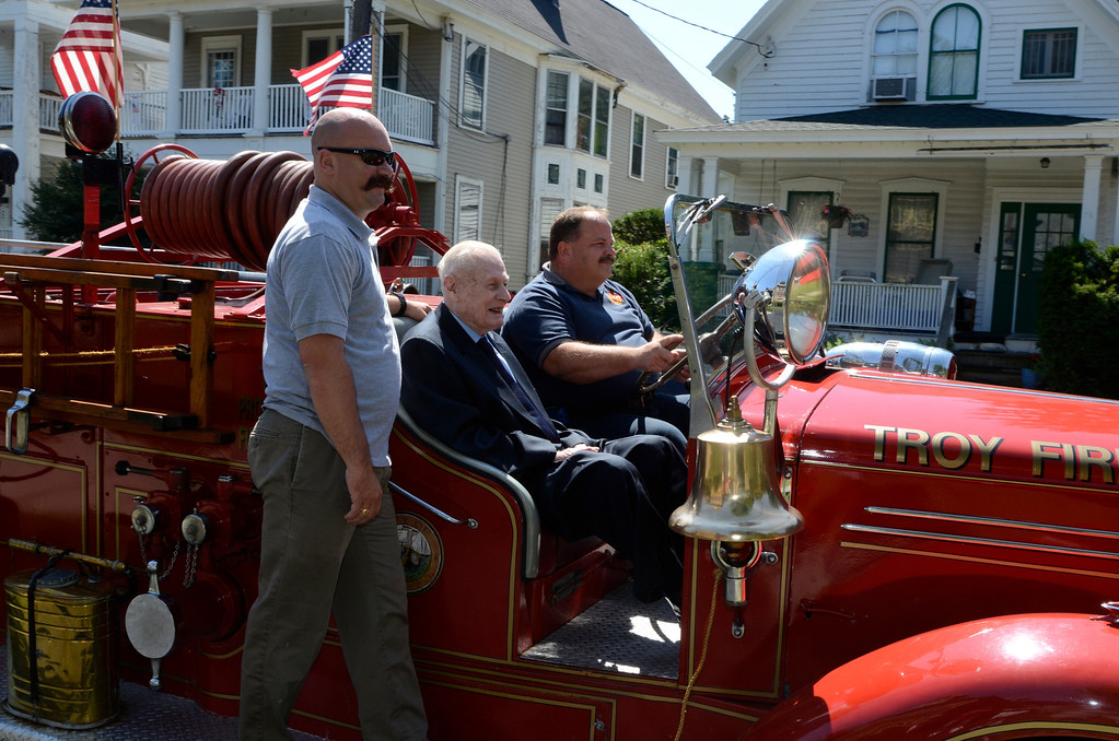 . Troy firefighter Mike DeForge, Frank J. Kennedy and  Troy Firefighter Eric Wisher, ride a 1947 Mack Fire Pumper. Frank J. Kennedy, the oldest living Troy firefighter, celebrated his 100th birthday (August 22) with a ride on an antique 1947 Mack fire truck to his last fire station on Canal Ave in Troy, N.Y., Sunday, August 25, 2013.. (Mike McMahon/The Record)
