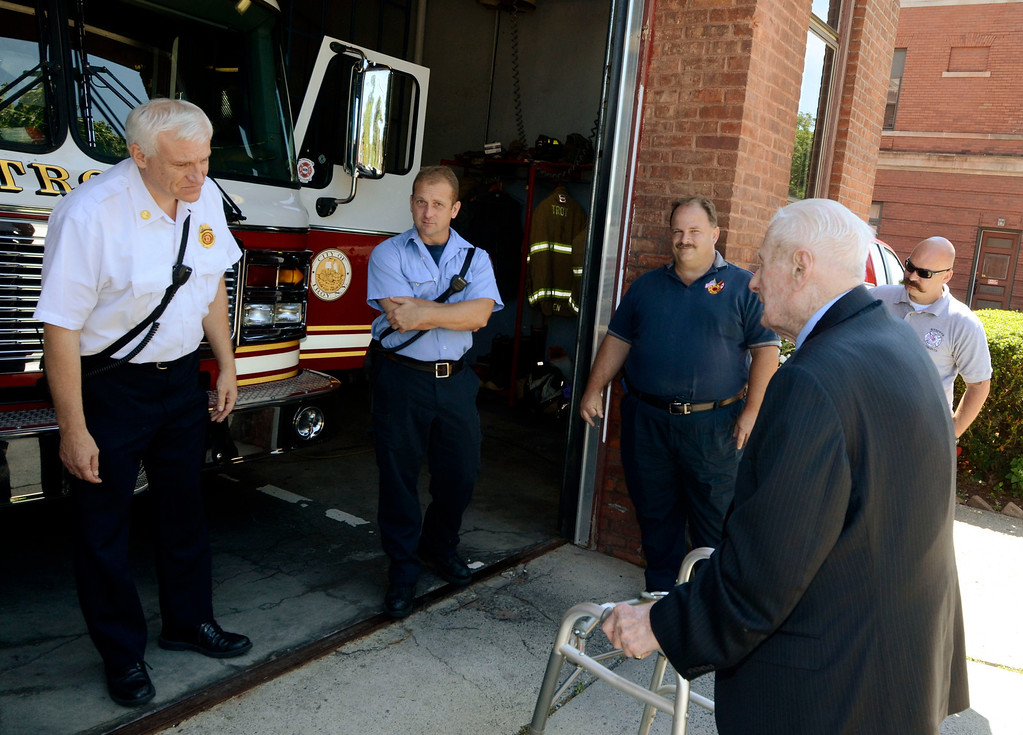 . Frank J. Kennedy, the oldest living Troy firefighter, celebrated his 100th birthday (August 22) with a ride on an antique 1947 Mack fire truck to his last fire station on Canal Ave in Troy, N.Y., Sunday, August 25, 2013.. (Mike McMahon/The Record)